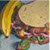 Feb 11: Ham sandwich, mustard, Romaine, oatmeal bread, olive, and banana...almost lunch